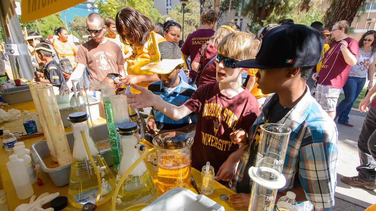 kids at science tent for ASU Block Party