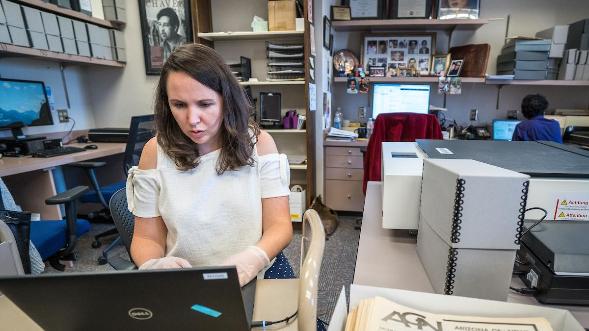 Archivist scans historical documents and photographs