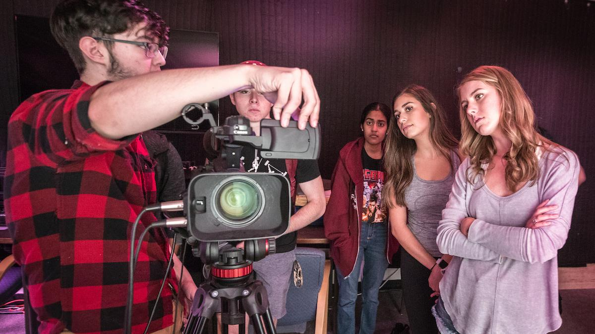 students learn how to operate a camera in the makerstudio