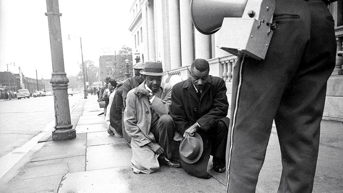 Rev. Charles Billups kneels in prayer along side Rev. Fred Shuttlesworth as their march in April of 1963 is stopped in front of the Federal Courthouse in Birmingham, AL (The Birmingham News file photo)