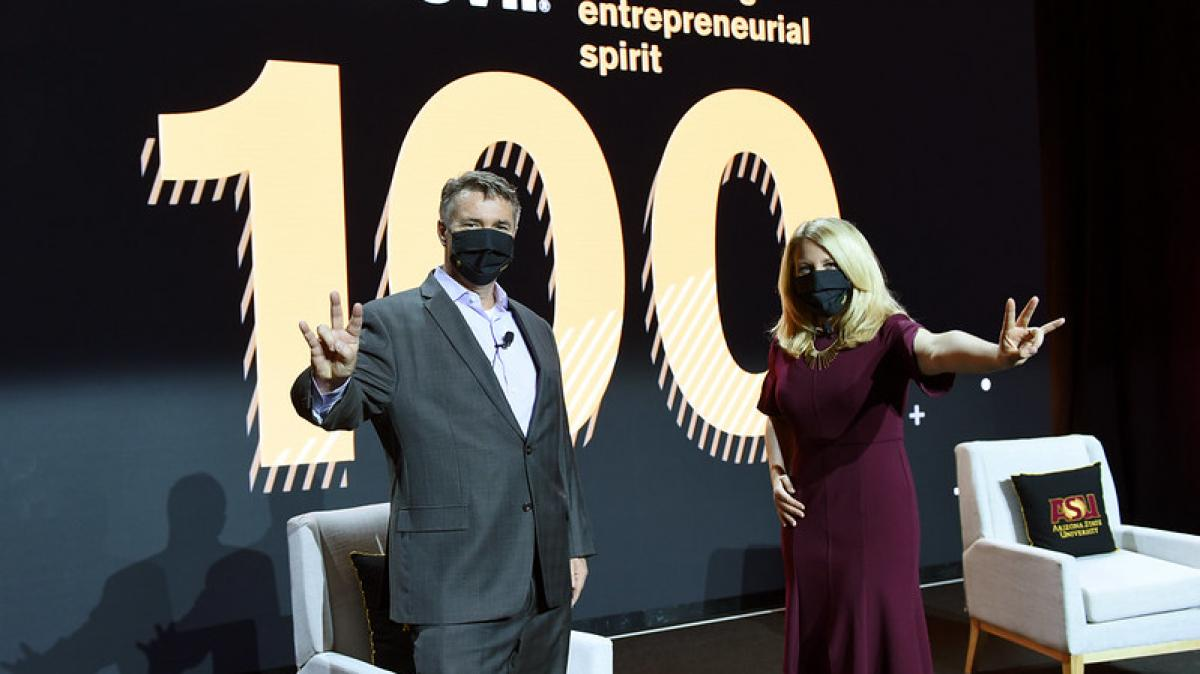 Ray Schey and Kylee Cruz throw up Pitchforks before Sun Devil 100 event