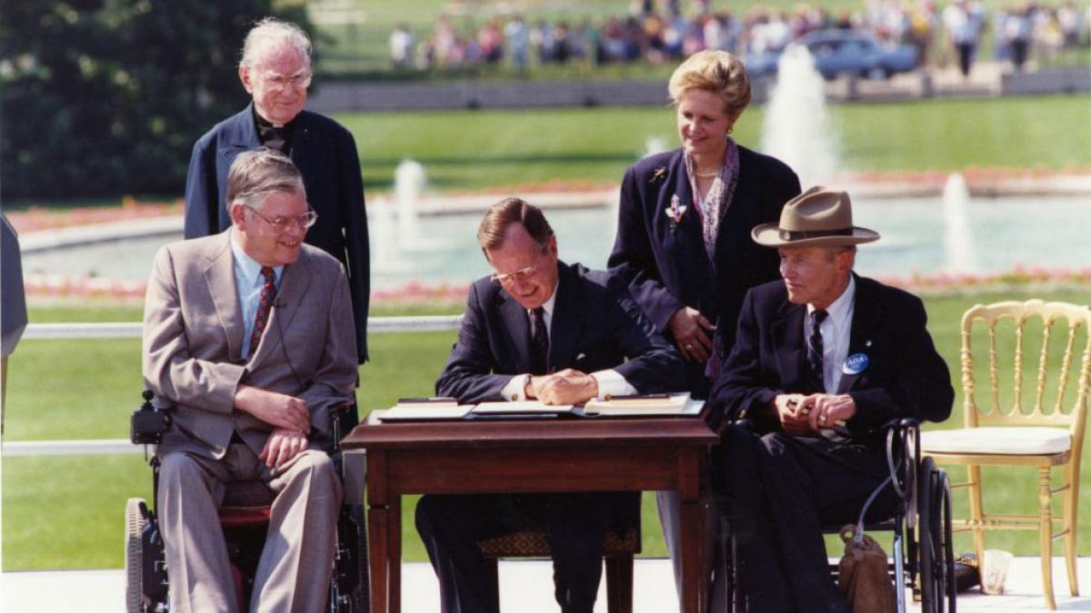 President George Bush signed the Americans with Disabilities Act (ADA) on the South Lawn of the White House.