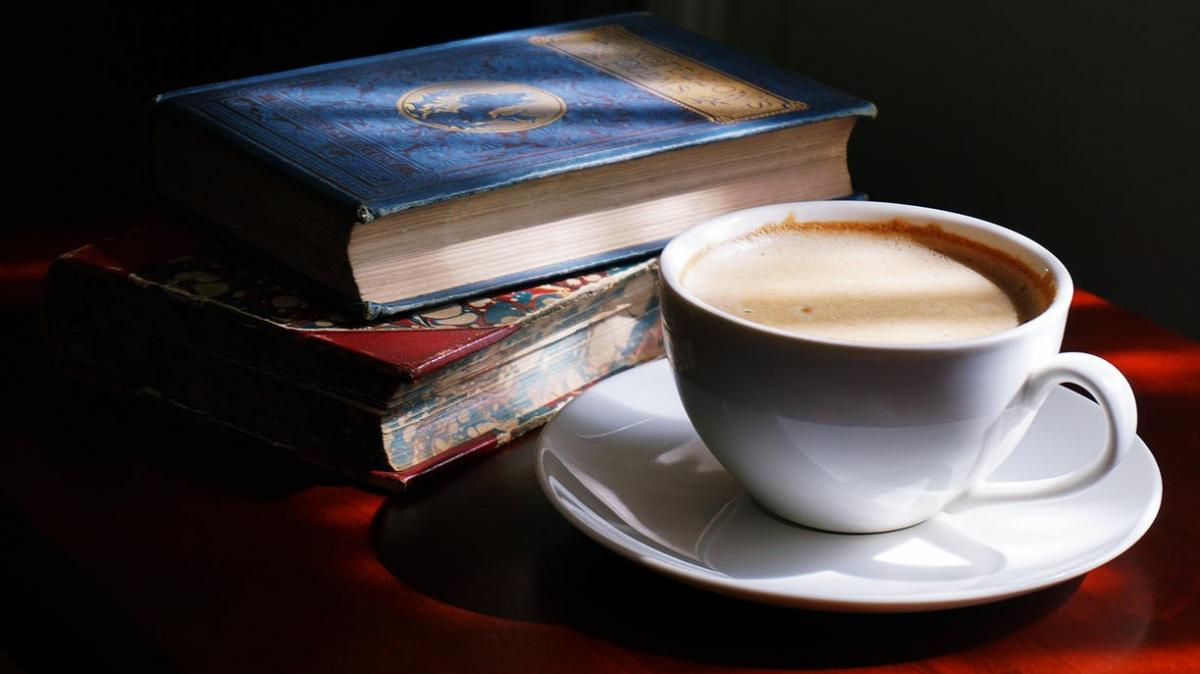 Image of coffee and books / Photo by Suzy Hazelwood on Pexels
