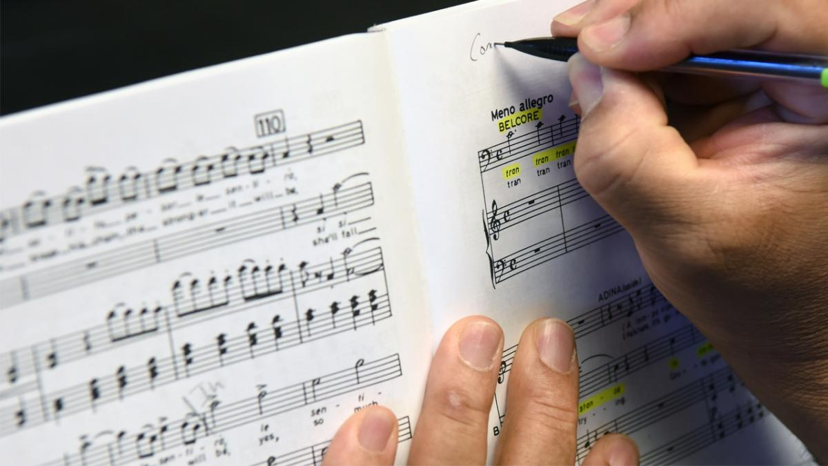 photo of a composer annotating music