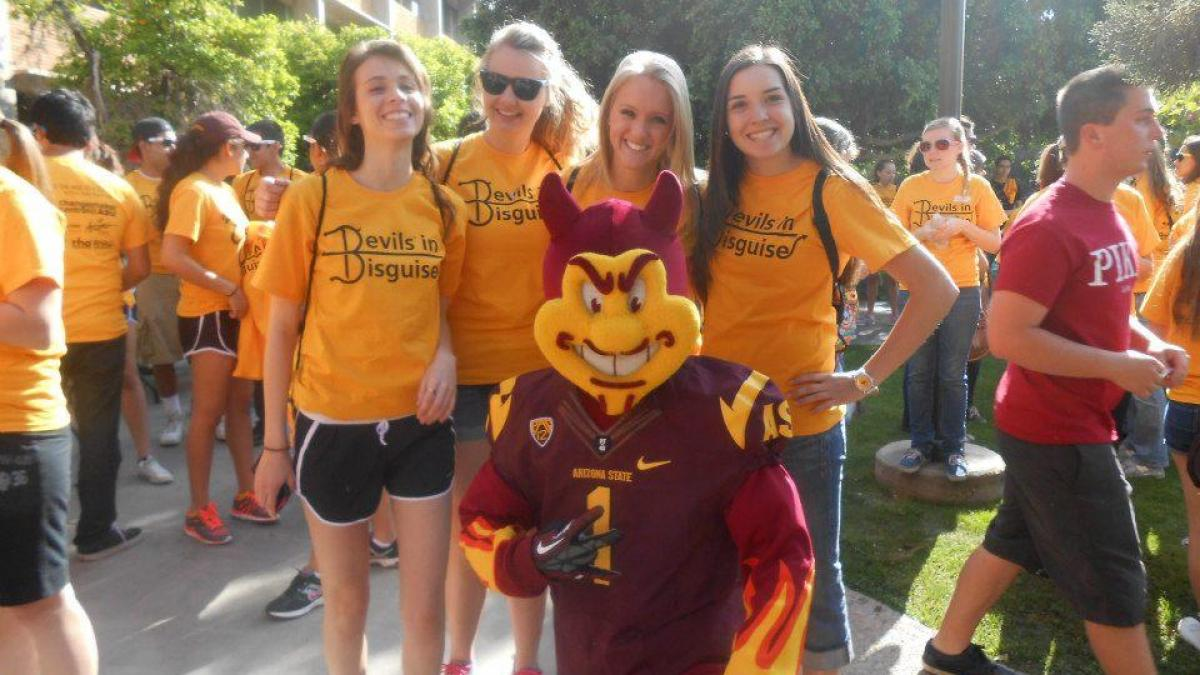 students and Sparky posing during Devils in Disguise event