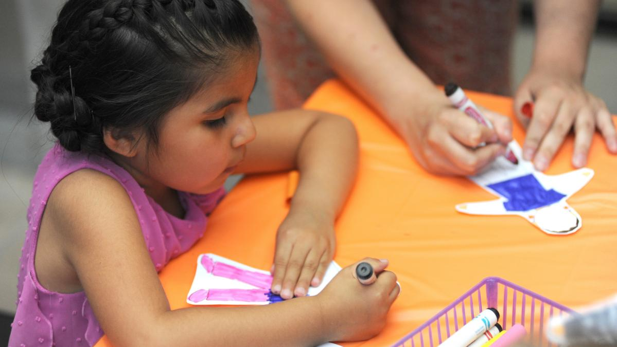 A young girl works on an art project at First Saturday for Families at the ASU Art Museum