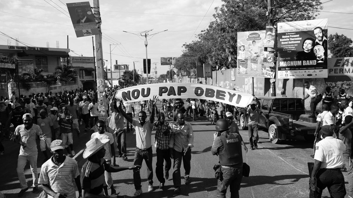 Image credit: Frente 3 de Fevereiro, Nou Pap Obeyi [No Vamos Obedecer / We Will Not Obey] action, 2015. Photo: Daniel Lima.