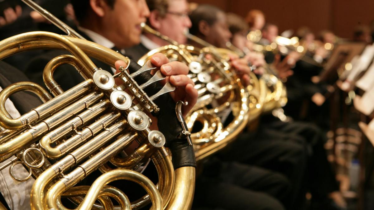 Photo of a horn ensemble performance