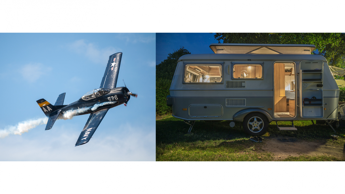 airplane flying in sky and travel trailer in woods