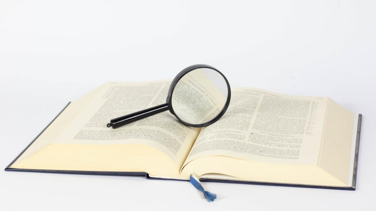 Magnifying glass on a book / Image by Marco Verch on Flickr