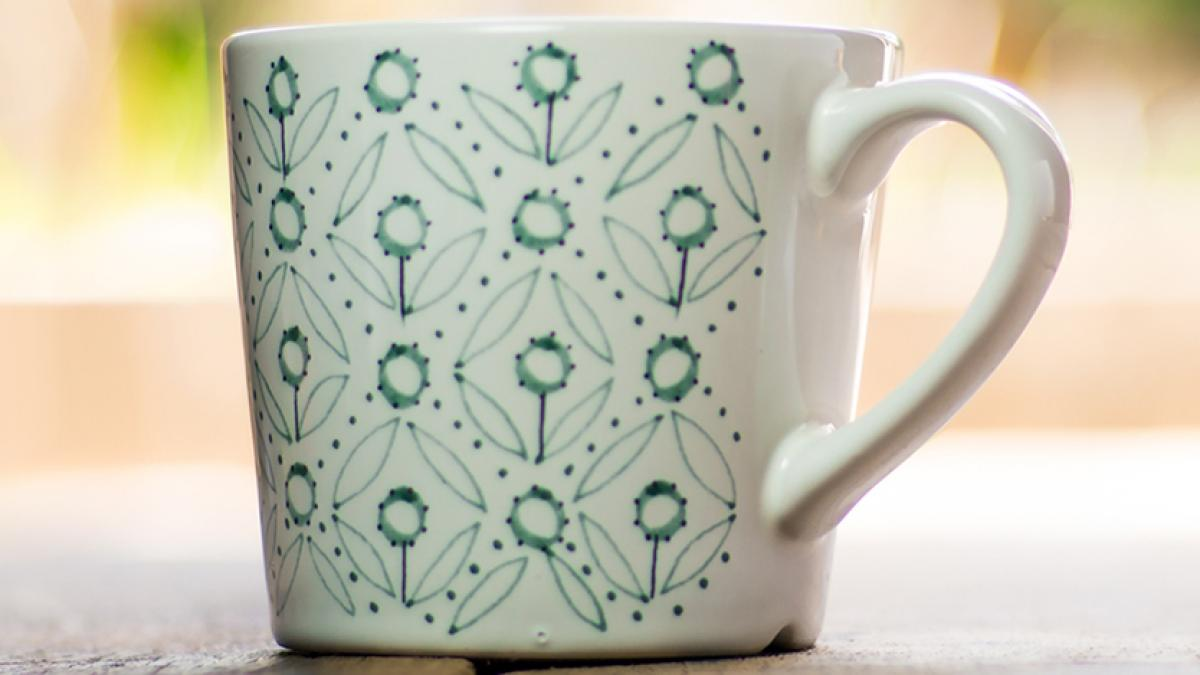 Coffee cup with blue flowers