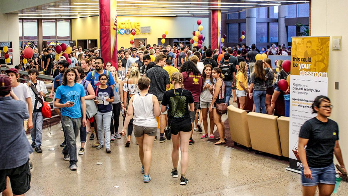 Picture of a large groups of students walking through the Sun Devil Fitness Complex lobby