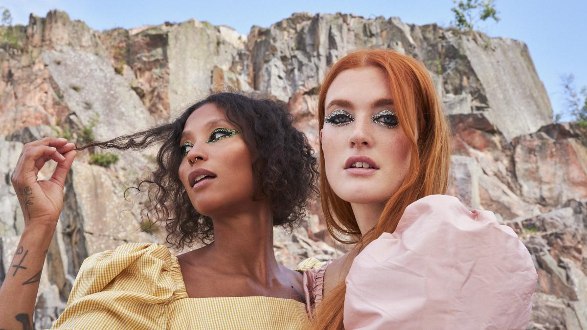 two women who make up Icona Pop pose for close up portrait photo