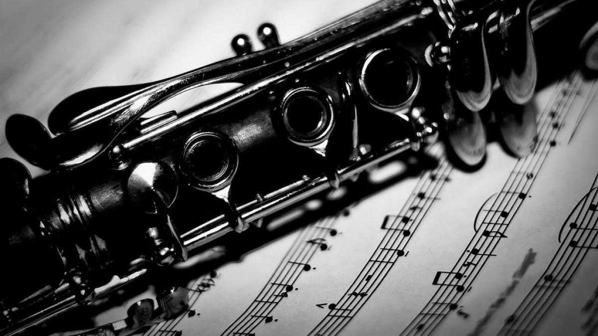 Photo of a clarinet over sheet music